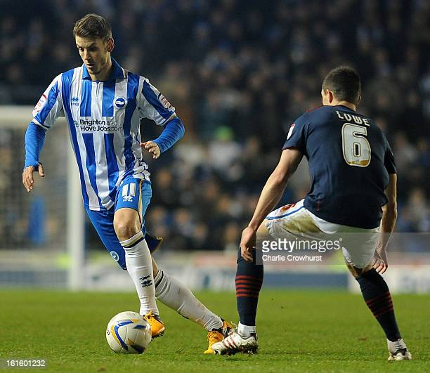 Andrea Orlandi of Brighton Hove Albion takes the ball past Jason Lowe of Blackburn Rovers during the npower Championship match between Brighton Hove...