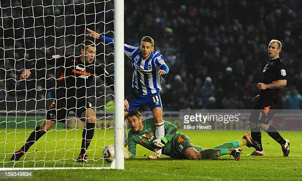 Andrea Orlandi of Brighton is denied by Paul Coutts of Derby as goalkeeper Adam Legzdins and Gareth Roberts of Derby look on during the npower...
