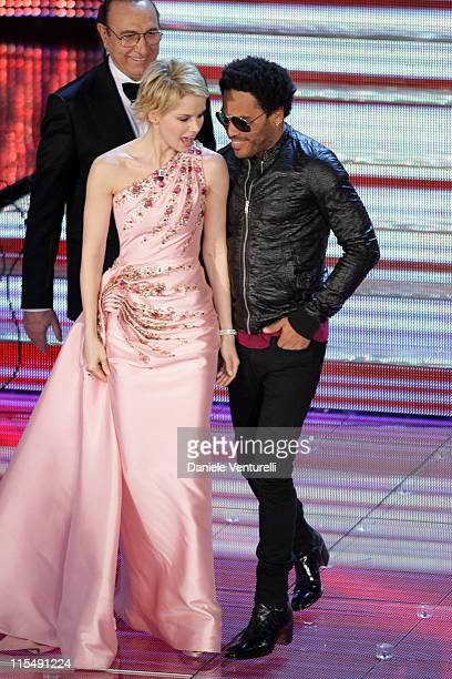 Andrea Osvart and Lenny Kravitz perform at the Teatro Ariston, during the first day of the 58th Sanremo Music Festival, on February 25, 2008 in...