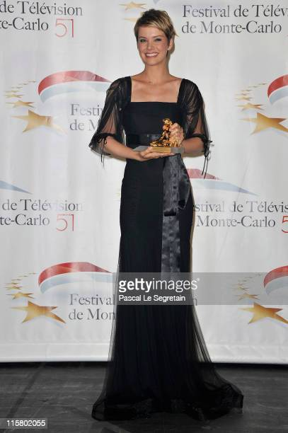 Andrea Osvart poses with her Golden Nymphe award after the closing ceremony of the 2011 Monte Carlo Television Festival held at the Grimaldi Forum on...