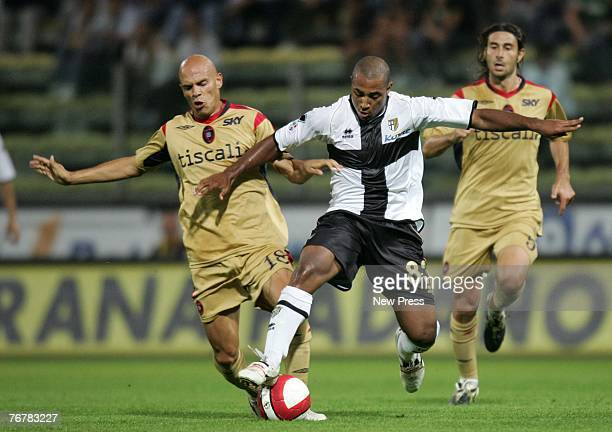 Andrea Parola of Cagliari and Ferreira Reginaldo of Parma fight for the ball during a Serie A match between Parma and Cagliari at the Stadio Ennio...