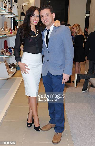 Andrea Parra and Rodrigo Lopez attend the opening of the Stuart Weitzman Boutique on April 17 2013 in Toronto City