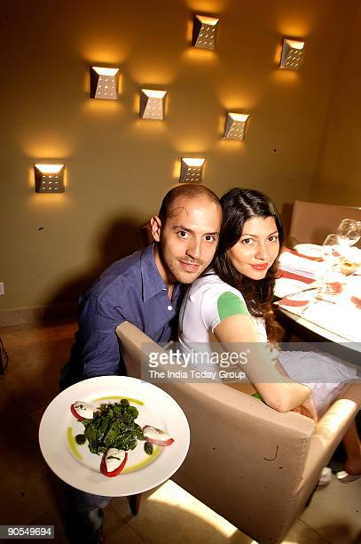 Andrea Pauro with his wife Pia owner of Baci Restaurant at his Restaurant in Sunder Nagar market New Delhi India