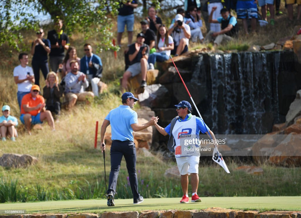 Andrea Pavan of Italy and caddie celebrate a birdie on the 16th green during day four and final round of the the D+D REAL Czech Masters at Albatross Golf Resort on August 26, 2018 in Prague, Czech Republic.