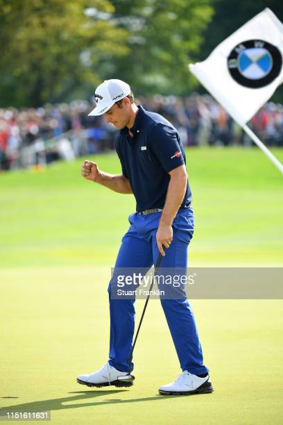 Andrea Pavan of Italy celebrates on the 18th green after his victory during a playoff during day four of the BMW International Open at Golfclub...