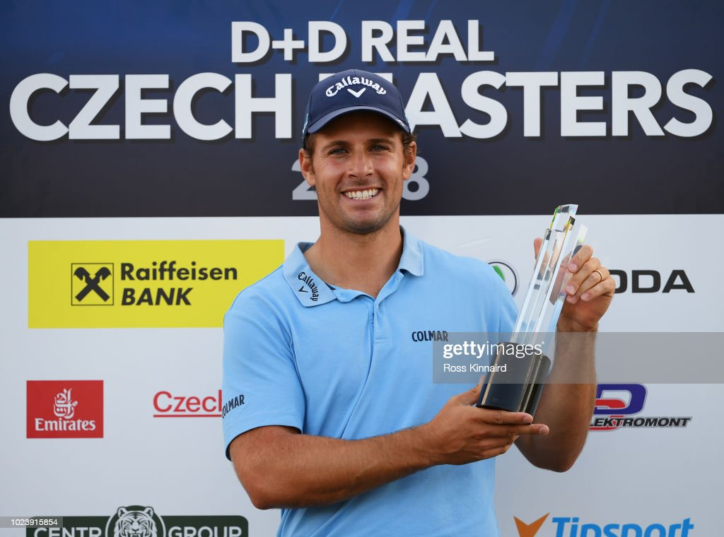 Andrea Pavan of Italy celebrates victory with the the trophy on day four and final round of the the D+D REAL Czech Masters at Albatross Golf Resort on August 26, 2018 in Prague, Czech Republic.