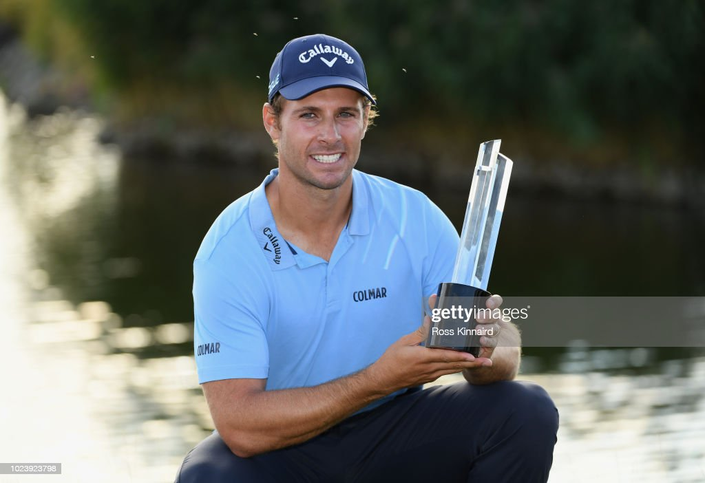 Andrea Pavan of Italy celebrates victory with the trophy on day four and final round of the the D+D REAL Czech Masters at Albatross Golf Resort on August 26, 2018 in Prague, Czech Republic.