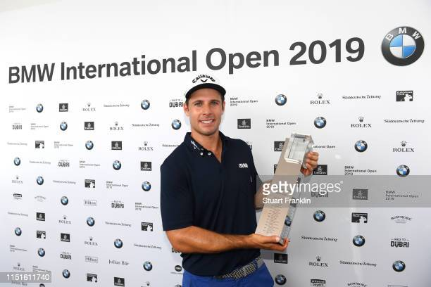 Andrea Pavan of Italy poses with the trophy after his victory during a playoff during day four of the BMW International Open at Golfclub Munchen...
