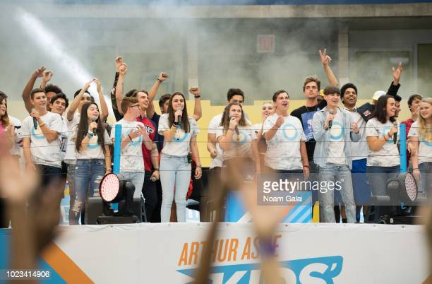 Andrea Pena Sawyer Garrity and members of Shine MSD from Marjory Stoneman Douglas High School perform at the 2018 Arthur Ashe Kids' Day at USTA...