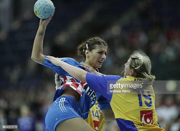 Andrea Penezic of Croatia is challenged by Johanna Ahlm of Sweden during the women's handball Olympic qualification tournament match between Sweden...