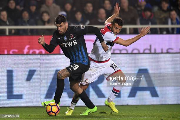 Andrea Petagna of Atalanta and Gianmarco Ferrari of Crotone compete for the ball during the Serie A match between Atalanta BC and FC Crotone at...