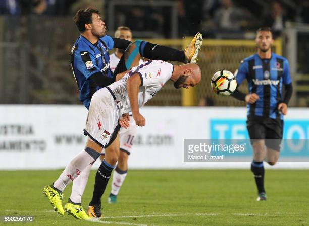 Andrea Petagna of Atalanta BC competes for the ball with Arlind Ajeti of FC Crotone during the Serie A match between Atalanta BC and FC Crotone at...