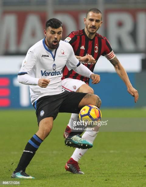 Andrea Petagna of Atalanta BC competes for the ball with Leonardo Bonucci of AC Milan during the serie A match between AC Milan and Atalanta BC at...
