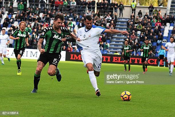 Andrea Petagna of Atalanta BC competes the ball with Francesco Acerbi of US Sassuolo during the Serie A match between US Sassuolo and Atalanta BC at...