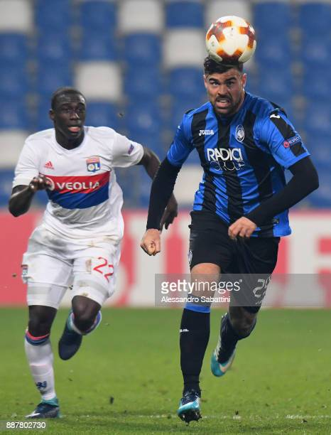 Andrea Petagna of Atalanta competes for the ball whit Ferland Mendy of Olympique Lyon during the UEFA Europa League group E match between Atalanta...