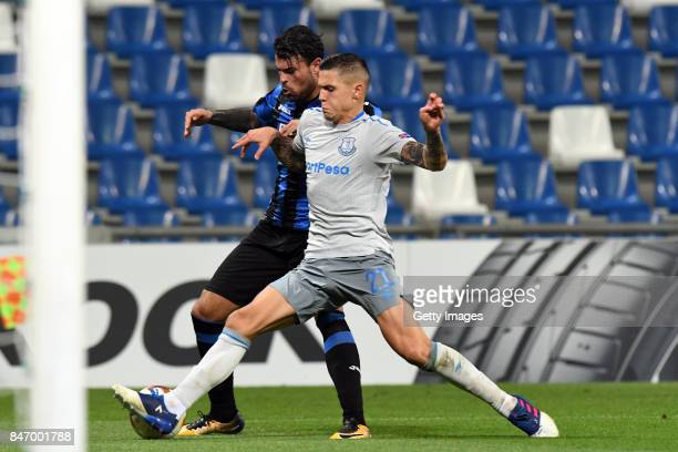 Andrea Petagna of Atalanta competes for the ball with Muhamed Besic of Everton FC during the UEFA Europa League group E match between Atalanta and...