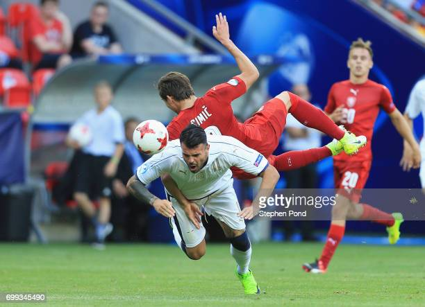 Andrea Petagna of Italy and Stefan Simic of Czech Republic compete for the ball during the UEFA European Under21 Championship Group C match between...