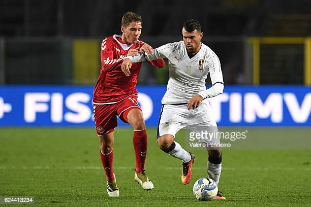 Andrea Petagna of Italy is challenged by Robert Skov of Denmark during the International Friendly match between Italy U21 and Denmark U21 at Stadio...