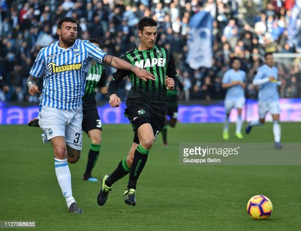 Andrea Petagna of SPAL and Federico Peluso of US Sassuolo in action during the Serie A match between US Sassuolo and SPAL at Mapei Stadium Citta' del...