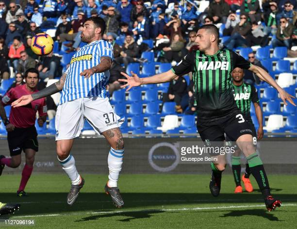 Andrea Petagna of SPAL and Merih Demiral of US Sassuolo in action during the Serie A match between US Sassuolo and SPAL at Mapei Stadium Citta' del...