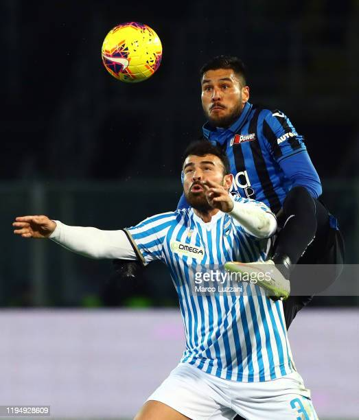 Andrea Petagna of Spal competes for the ball with Jose Luis Palomino of Atalanta BC during the Serie A match between Atalanta BC and SPAL at Gewiss...