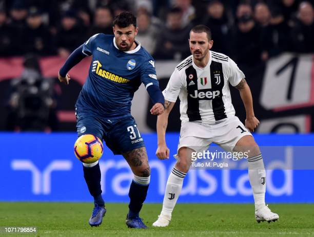 Andrea Petagna of Spal competes for the ball with Leonardo Bonucci of Juventus during the Serie A match between Juventus and SPAL at Allianz Stadium...
