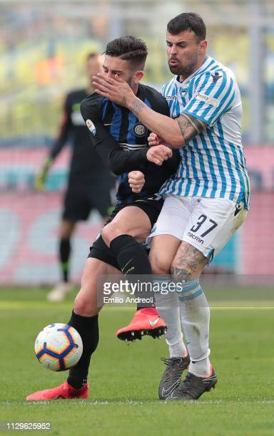 Andrea Petagna of Spal competes for the ball with Roberto Gagliardini of FC Internazionale during the Serie A match between FC Internazionale and...