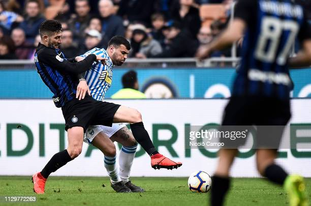 Andrea Petagna of SPAL competes for the ball with Roberto Gagliardini of FC Internazionale during the Serie A football match between FC...
