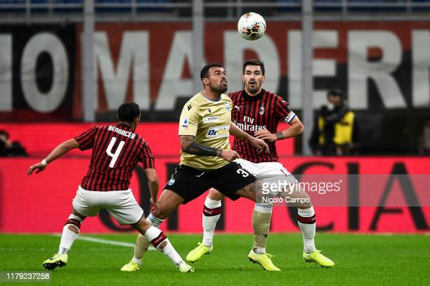 Andrea Petagna of SPAL is challenged by Ismael Bennacer and Alessio Romagnoli of AC Milan during the Serie A football match between AC Milan and SPAL...