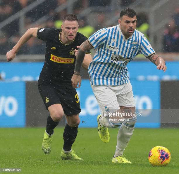 Andrea Petagna of Spal is challenged by Milan Skriniar of FC Internazionale during the Serie A match between FC Internazionale and SPAL at Stadio...