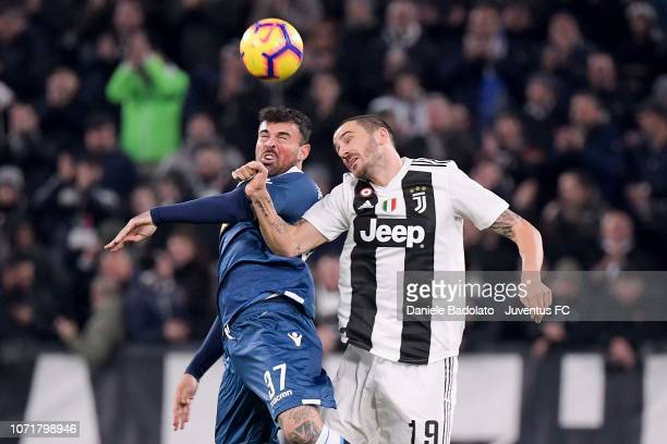 Andrea Petagna of Spal wins a header over Leonardo Bonucci of Juventus during the Serie A match between Juventus and SPAL at Allianz Stadium on...