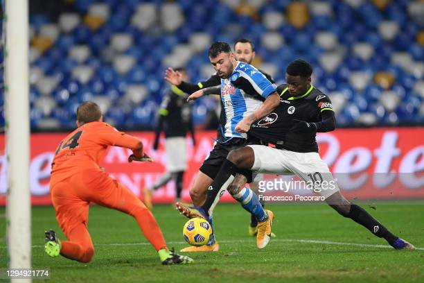 Andrea Petagna of S.S.C. Napoli is challenged by Lucien Agoume of Spezia during the Serie A match between SSC Napoli and Spezia Calcio at Stadio...