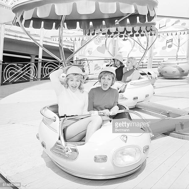 Andrea Peters and Sasha Alexander help test out a ride for an amusement park that will soon open in Palisades Park New Jersey March 24 1964