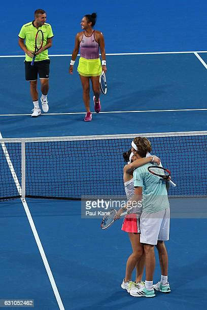 Andrea Petkovic and Alexander Zverev of Germany celebrate winning the mixed doubles match against Heather Watson and Dan Evans of Great Britain...