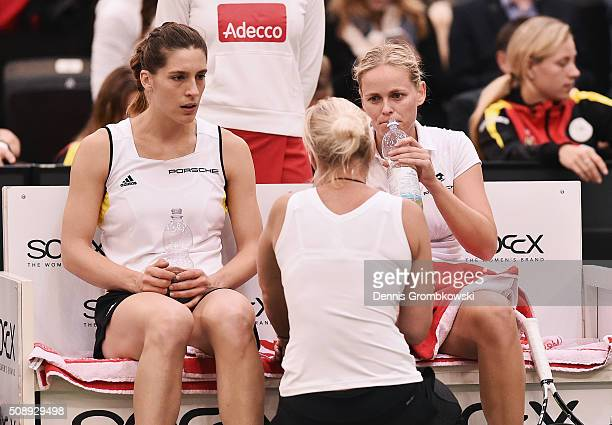Andrea Petkovic and AnnaLena Groenefeld of Germany look dejected in their double match against Martina Hingis and Belinda Bencic of Switzerland on...