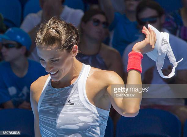 Andrea Petkovic of Germany aknowledges the spectators after defeating Kristina Mladenovic of France during their third session women's singles match...