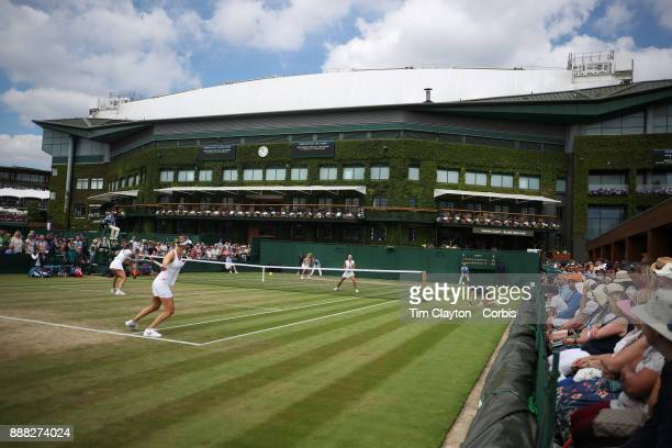 Andrea Petkovic of Germany and Mirjana LucicBaroni of Croatia playing their Ladies' Doubles match against Lucie Hradecka of the Czech Republic and...