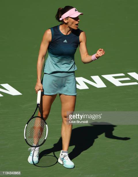 Andrea Petkovic of Germany celebrates a point against Venus Williams of the United States during their womens singles first round match on day four...