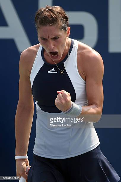 Andrea Petkovic of Germany celebrates after defeating Elena Vesnina of Russian in their Women's Singles Second Round match on Day Four of the 2015 US...