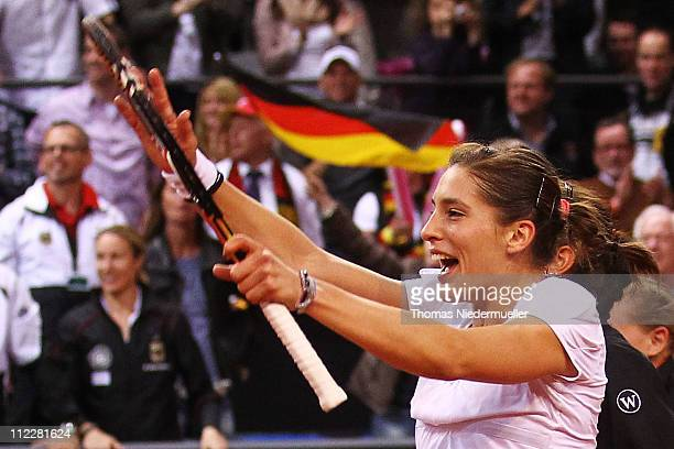 Andrea Petkovic of Germany celebrates after her match against Melanie Oudin of USA during the second day of the Fed Cup match between Germany and...