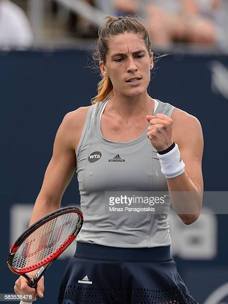 Andrea Petkovic of Germany celebrates after scoring a point against Alize Cornet of France during day two of the Rogers Cup at Uniprix Stadium on...