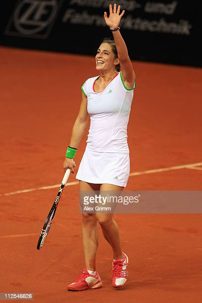 Andrea Petkovic of Germany celebrates after winning her first round match against Tamira Paszek of Austria at the Porsche Tennis Grand Prix at...