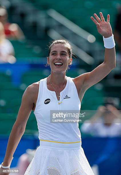 Andrea Petkovic of Germany celebrates after winning her match against Carina Witthoeft of Germany during day one of the Bank of the West Classic at...