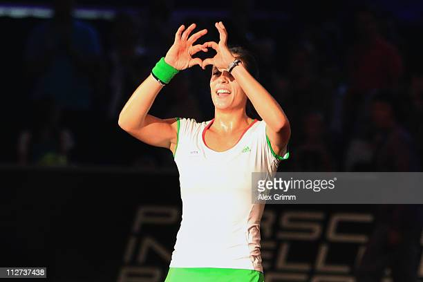 Andrea Petkovic of Germany celebrates after winning her second round match against Jelena Jankovic of Serbia at the Porsche Tennis Grand Prix at...