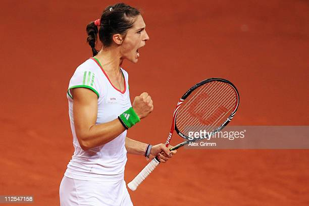 Andrea Petkovic of Germany celebrates during her first round match against Tamira Paszek of Austria at the Porsche Tennis Grand Prix at Porsche Arena...