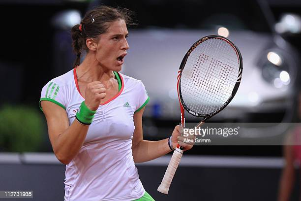 Andrea Petkovic of Germany celebrates during her second round match against Jelena Jankovic of Serbia at the Porsche Tennis Grand Prix at Porsche...