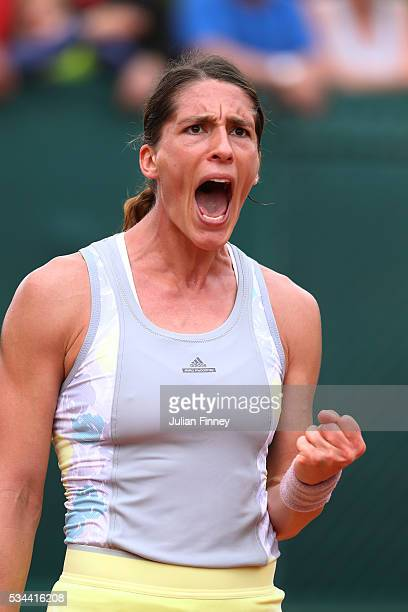Andrea Petkovic of Germany celebrates during the Ladies Singles second round match against Yulia Putintseva of Kazakstan on day five of the 2016...