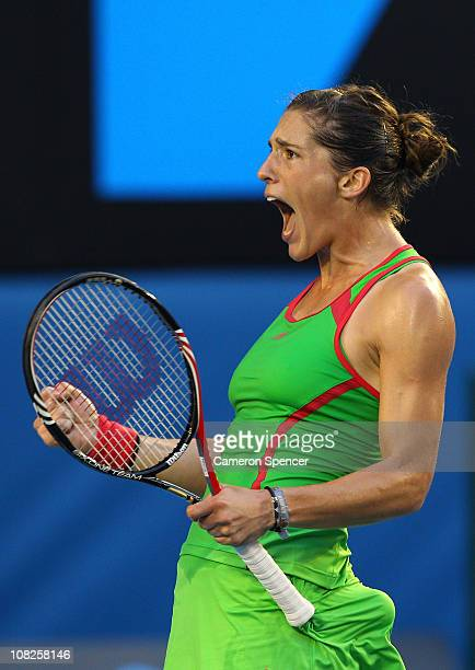 Andrea Petkovic of Germany celebrates her match point after winning her fourth round match against Maria Sharapova of Russia during day seven of the...