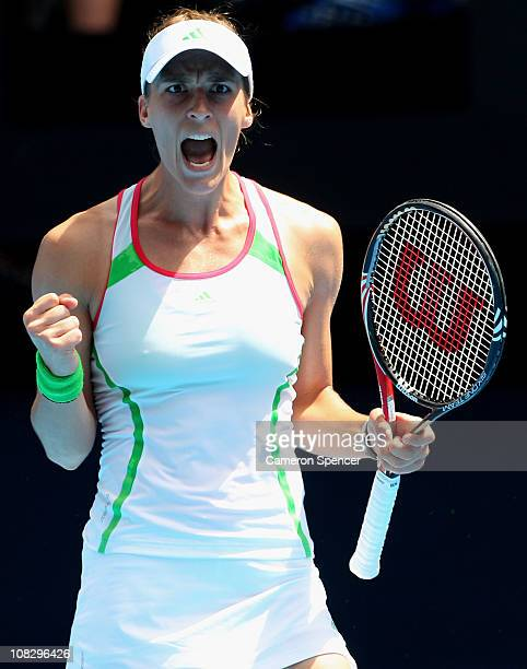 Andrea Petkovic of Germany celebrates winning a point in her quarterfinal match against Na Li of China during day nine of the 2011 Australian Open at...