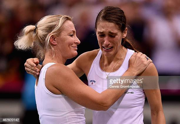 Andrea Petkovic of Germany celebrates with team captai Barbara Rittner after her victory in her single match against Samantha Stosur of Australia...